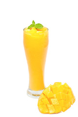 Fresh mango juice in a glass over white background