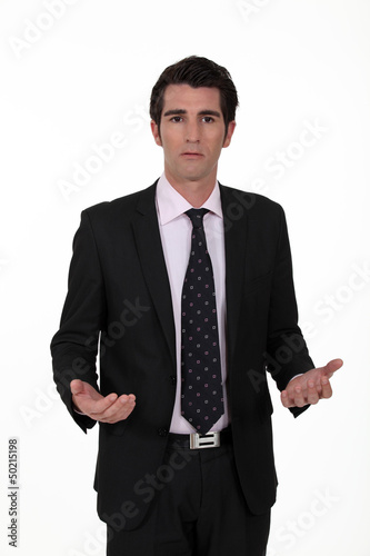businessman looking lost and confused
