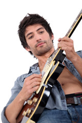 young man playing electrical guitar