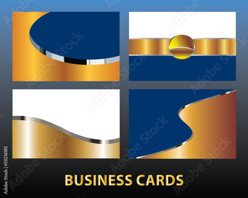 Four blank gold business cards