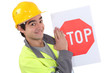 Road worker holding a stop sign.