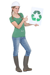 Apprentice holding recycling logo