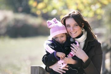mother holding her little girl