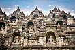 A statue of the Borobudur temple on Java , Indonesia.