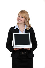 Blond woman presenting laptop