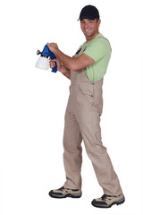 Man holding a spray gun