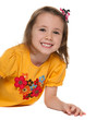 Cheerful small girl in a yellow shirt