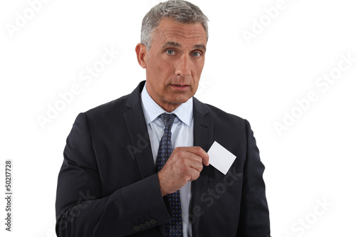 Executive pulling businesscard from pocket