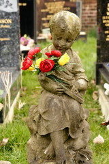 infant statue in cemetery
