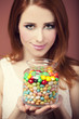 young woman holding a bowl full of jelly beans