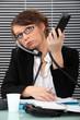 Secretary with two phones