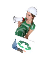 Woman with recycle poster
