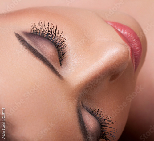 Eye with  long eyelashes.   High quality image.