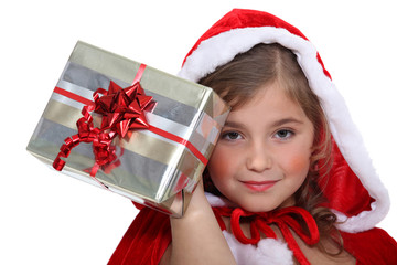 little girl dressed as a Santa Claus holding a present