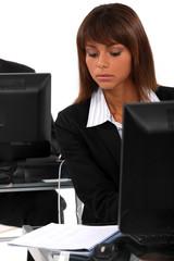 Brunette in an open plan office