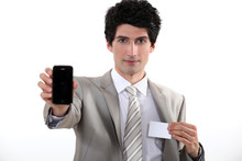 Businessman Holding A Blank Business Card And His Phone Sticker