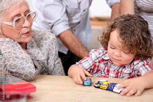 Grandmother and little boy playing