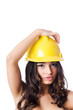 Young woman with hellow hard hat on white