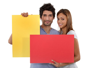 Couple with yellow and red blank cards