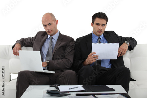 Businessmen working together in presentation