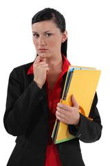 serious businesswoman holding folders