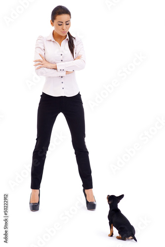 Sexy brunette model posing against small dog