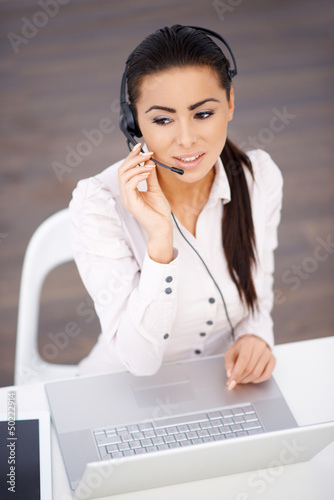 High angle shot of business woman sitting at the desk