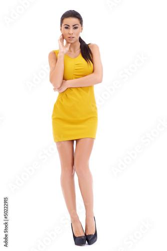 Sexy brunette model posing on white