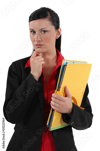 serious businesswoman holding folders