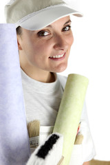 Decorator holding a roll of wallpaper