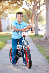 Boy Riding Bike On Path