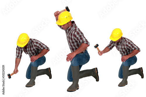 Tradesman using a hammer