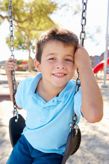 Boy On Swing In Park