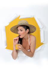a woman drinking orange juice