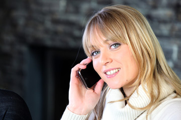 portrait of young blond woman on the phone