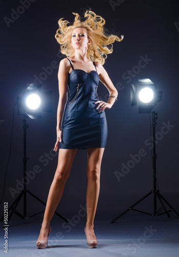 Young attractive woman in photo studio