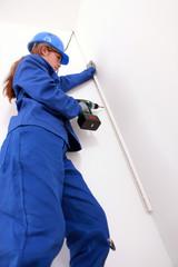 Woman screwing a molding