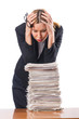 Woman with pile of papers
