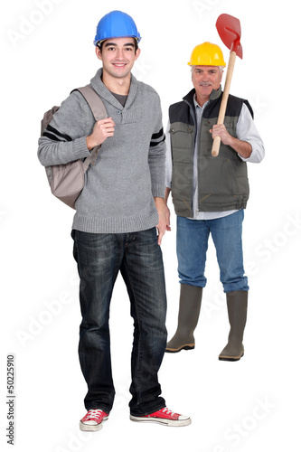Manual worker with apprentice