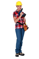 Female worker with a drill