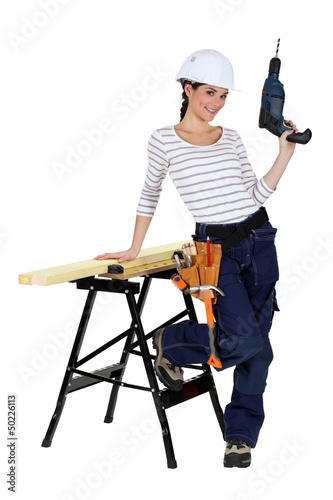Woman with drill and work-bench