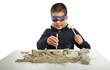 Child archaeologist excavating dinosaur skeleton