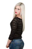 Beautiful young sexy woman with long blond hair wearing jeans