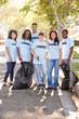 Team Of Volunteers Picking Up Litter In Suburban Street