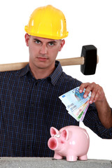 Laborer putting bills in a piggy bank