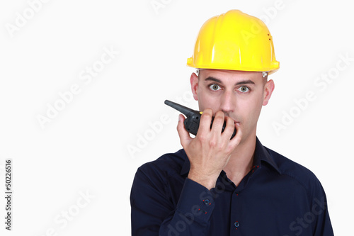 A foreman talking over the phone.