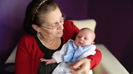 newborn baby with grandmother