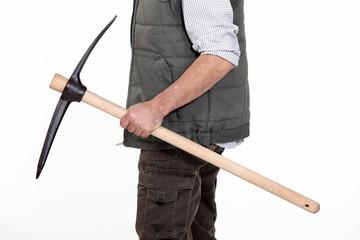 bricklayer holding pickaxe in studio