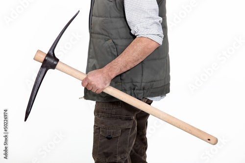 bricklayer holding pickaxe in studio