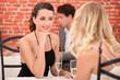 Two female friends having meal in posh restaurant